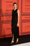 Rooney Mara in a black high-low Calvin Klein collection dress with black satin peep toe ankle strap sandals.