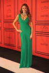 Sofia Vergara in an emerald ruched Herve L. Leroux gown