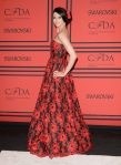 Stacey Bendet in a red printed Alice + Olivia strapless gown
