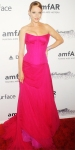Uma Thurman in a magenta strapless corseted top with an airy chiffon skirt by Versace & Chopard jewelry.