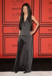 Vera Wang in a black high slit tunic outfit