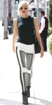 Gwen Stefani in a black sleeveless top with printed black & white pants & caged booties.