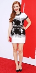 Holland Roden in a black & white floral dress by Naeem Khan with a red Lauren Merkin clutch & stud earrings by Tacori.