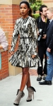 Kelly Rowland in a zebra printed dress with a flared skirt & gray towering booties.