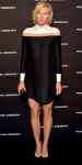 Maria Sharapova in a colorblock shift dress by Valentino with black pointy toe pumps.