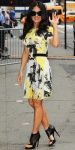 Salma Hayek Pinault in a floral pleated dress by Christopher Kane with black cut-out booties.