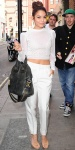 Vanessa Hudgens in a sheer white cropped sweater by Catherine Malandrino with white Houghton cigarette pants, & nude ankle atrap Giuseppe Zanotti heels.