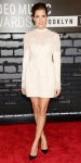 Allison Williams in a long-sleeved white dress with black pumps & earrings by PHYNE by Paige Novick.
