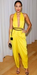 Ashley Madekwe in a deep-v yellow jumpsuit by Diane von Furstenberg with a vintage Chanel belt, Jimmy Choo clutch, & black Saint Laurent pumps.
