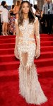 Ciara in a feathered Givenchy Couture gown with Lorrain Schwartz stud earrings.