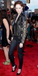 Coco Rocha in an embellished leather Fausto Puglisi jacket with black skinny jeans & pumps.