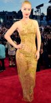 Iggy Azalea in a gold embroidered Emilio Pucci dress.