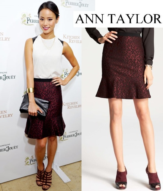 Jamie Chung in a wite leather-accented top with a leopard print jacquard Ann Taylor flounce skirt, a leather clutch by Gerard Darel, & black strappy heels.
