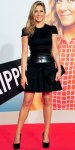 Jennifer Aniston in a black Alexander McQueen leather corseted dress with a rectangular Givenchy clutch & black pumps.