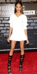 Joan Smalls in a little white dress by Viktor & Rolf with strappy Casadei boots.