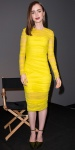 Lily Collins in a yellow ruched Versace dress with ankle-strap pumps by Casadei.