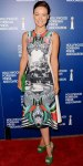 Olivia Wilde in a printed Clover Canyon dress with a green Jimmy Choo clutch & platform heels.