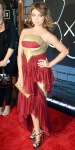 Sarah Hyland in a red & gold Marchesa dress with satin Casadei pumps.
