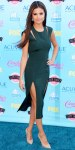Selena Gomez in a hunter green Cushnie et Ochs dress with drop earrings & nude Nicholas Kirkwood pumps.