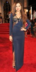 Selena Gomez in a navy high slit Atelier Versace dress with Lorraine Schwartz jewelry.