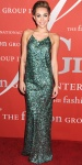 Miley Cyrus in a green sequined Marc Jacobs halter gown.