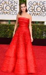 Allison Williams in a red strapless tiered Armani Prive gown with a Cartier bracelet.