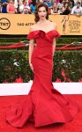Alysia Reiner in a red off-the-shoulder mermaid Christian Siriano gown.