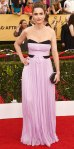 Amanda Peet in a lilac & black strapless J. Mendel gown & beaded Judith Leiber clutch.