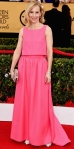 Amy Ryan in a pink top & ball gown skirt by Honor with white pinty toe bowed pumps & a metallic clutch.