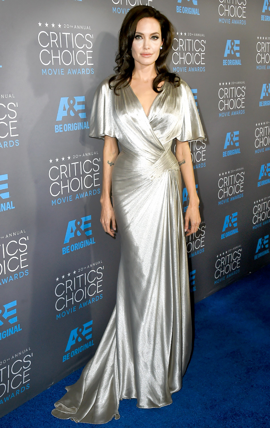 7afe7d64062c Angelina Jolie in a silver wrap Atelier Versace dress.