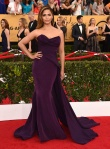 Camila Alves in a purple sweetheart scultped Donna Karan gown.