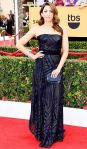 Chelsea Peretti in a navy embellished Rubin Singer strapless belted gown.