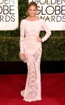 Chrissy Teigen in a cream sequin embellished beaded Zuhair Murad long sleeved column gown with Harry Kotlar jewelry.