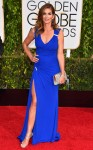 Cindy Crawford in a cobalt high slit Versace dress.
