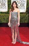 Dakota Johnson in a silver strapless high slit Chanel gown with Jimmy Choo sandals.