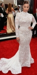Dascha Polanco in a white all-over lace long fishtail sleeve gown.