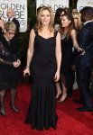 Edie Falco in a black sweetheart mermaid gown.