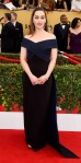Emilia Clarke in a midnight & black Donna Karan Atelier criss cross gown with jewelry by Cartier.