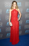 Emily Blunt in a red lace embellished Emilio Pucci dress with jewelry by Lorraine Schwartz.