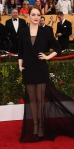 Emma Stone in a black tuxedo mini Dior Couture gown with a transparent train.