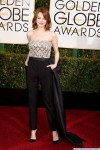 Emma Stone in silver & black Lanvin jumpsuit with makeup by Chanel.
