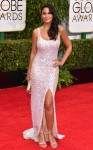 Emmanuelle Chriqui in a pale pink sparkling high slit gown.