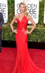 Heidi Klum in a red ruched & sequined Versace one-shoulder gown.