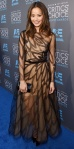 Jamie Chung in a sheer lace overlay Yanina Couture longsleeved dress.
