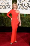 Jane Fonda in an orange asymmetrical cutout gown with jewelry by Bulgari.