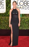 Jennifer Aniston in a black belted halter Saint Laurent gown.