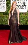 Jessica Chastain in a bronze deep-v Atelier Versace gown & Piaget jewelry.