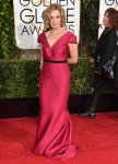 Jessica Lange in a crimson belted v-neck gown.