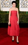 Julianna Margulies in a red strapless tea length dress by Juliana Sergeenko with black pumps with jewelry by Bulgari.