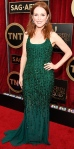 Julianne Moore in an emerald beaded Givenchy gown with jewelry by Chopard.